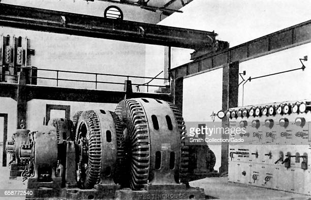 Photograph of the interior of an electrical substation showing Westinghouse equipment with dials and displays 1899