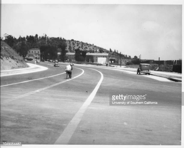 Photograph of the intersection of Figueroa Street and Alpine Street facing south, just after the offramp of the Pasadena Freeway. 'Received. Examiner...