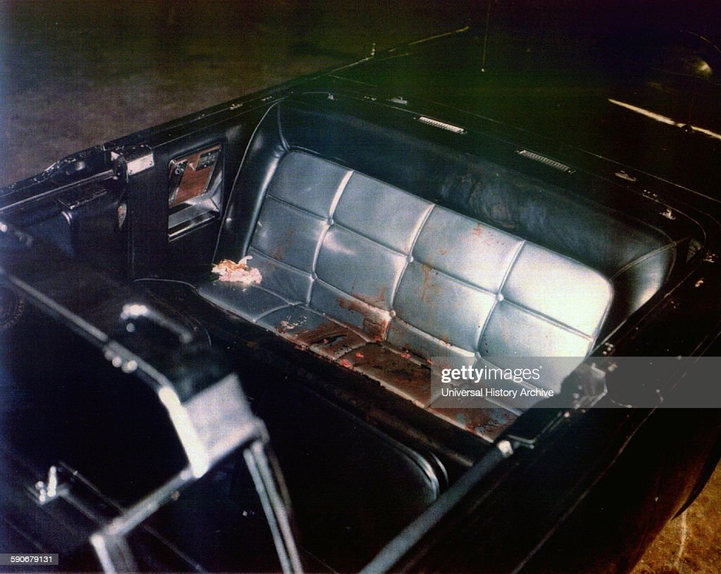 Photograph of the Kennedy limousine after assasination, Dallas. Dated 1963.