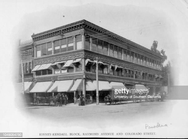 Photograph of the Kinney-Kendall Block, at the corner of Raymond Avenue and Colorado Street. Includes Metcalf's Pharmacy and Charles Gardner Dry...