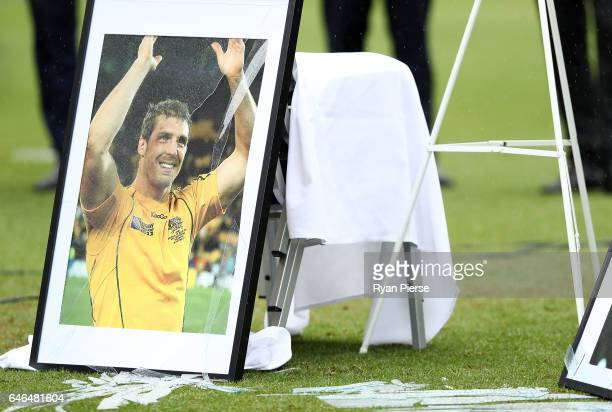 A photograph of the late Dan Vickerman is seen after it was broken by winds during the Public Memorial for former Australian Rugby Union player Dan...