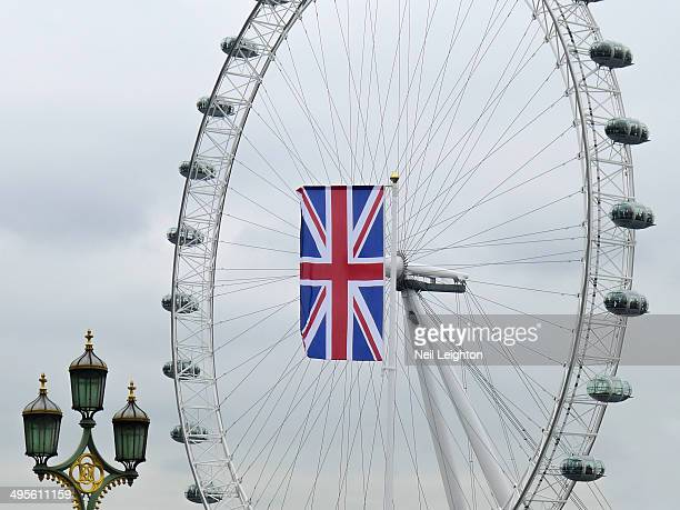 CONTENT] A photograph of the London Eye including a Union flag offset by ornate street lampsPicture taken 2012