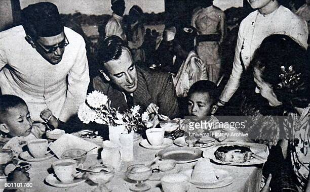 Photograph of the Louis Mountbatten 1st Earl Mountbatten of Burma meeting the children of Aung San a Burmese patriot Dated 20th Century