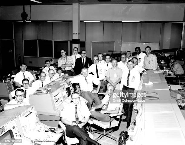 Photograph of the Mission Control Center flight support team for the Apollo 7 mission, Houston, Texas, December 19, 1968. Image courtesy National...