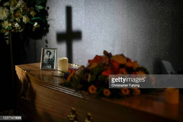 Photograph of the mother of Covid-19 victim Dennis Clapham, aged 62, adorns the top of his coffin before his funeral celebration at Guardian Funerals...