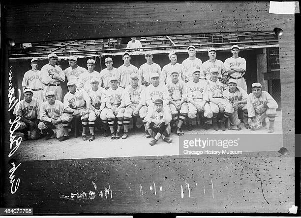 Photograph of the National League's Chicago Cubs baseball team posing in front of the dugout at Wrigley Field Chicago Illinois 1918