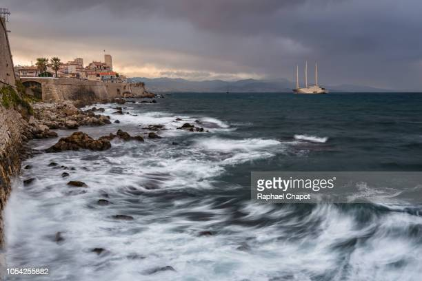 photograph of the old town of antibes and its fortifications during sunset, provence-alpes-côte-d'azur, france - antibes stock photos and pictures