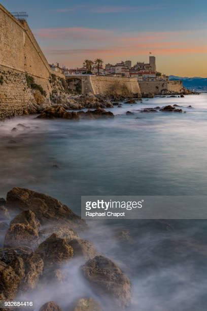 photograph of the old town of antibes and its fortifications during sunrise, provence-alpes-côte-d'azur, france - antibes stock photos and pictures