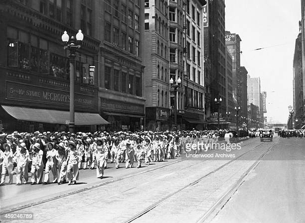 A photograph of the parade of 5000 marchers sponsored by the National Live Stock Meat Board to dramatize the importance of the meat industries and...