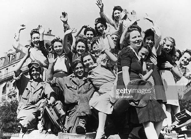 A Photograph of the People of Paris Thronged the Streets to Greet British American Canadian and French Troops who Entered the Freed City circa August...