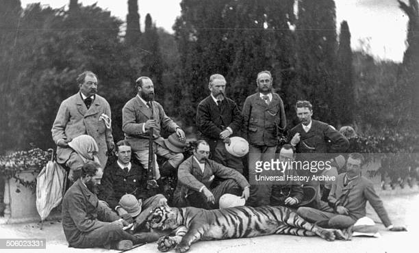 Photograph of The Prince of Wales holding rifle posing with members of his party and a dead tiger during his tour of India Dated 1875 Photo by