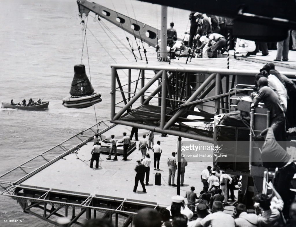 Photograph of the recovery sigma 7 which housed crew members of Mercury-Atlas 8, being hoisted aboard the USS Kearsarge. Dated 20th century.