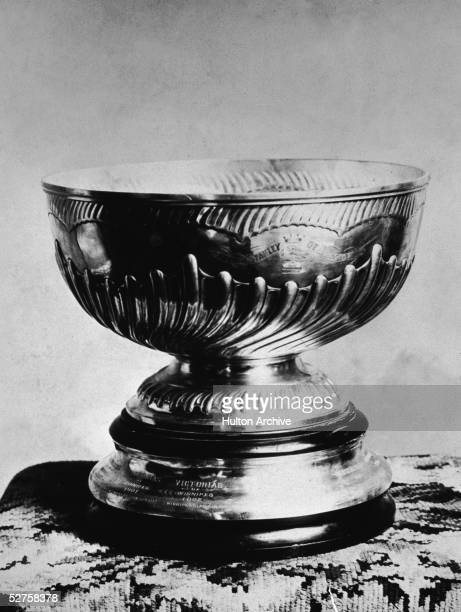 Photograph of the Stanley Cup addressed to the Winnipeg Victorias 1902 Shaped like a bowl mounted on a pedestal the Cup was first presented in 1893...