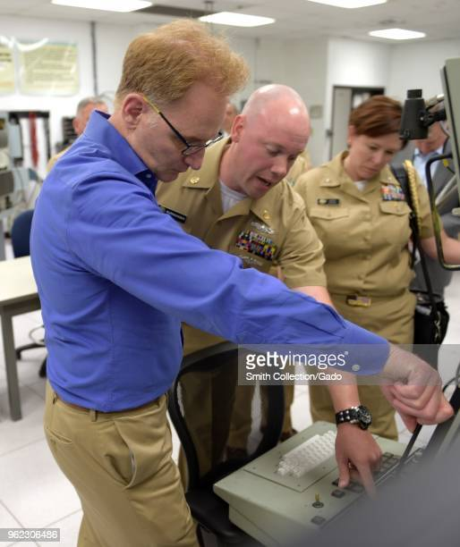 Photograph of the US navy's Chief Cryptologic Technician Michael Burngasser demonstrating AN/SLQ32 course equipment for Undersecretary of the Navy...
