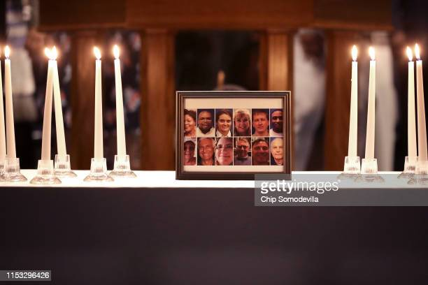 A photograph of the victims of a mass shooting is surrounded by 12 candles during a memorial service at Piney Grove Baptist Church June 02 2019 in...