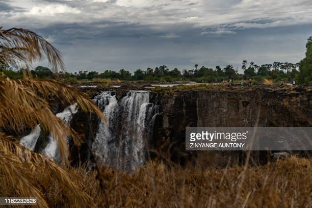A photograph of the Victoria Falls a UNESCO world heritage site measuring 108 metres high and almost 2km wide has recorded the lowest levels in...