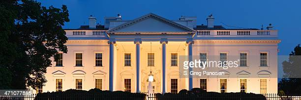 A photograph of the White House at night