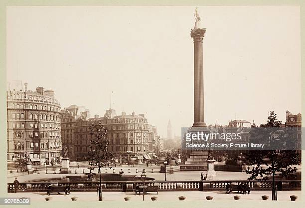 A photograph of Trafalgar Square in London with Nelson's Column dominating the view from an album containing sixty photographic views of London...