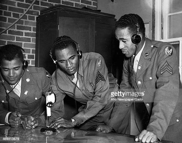 Photograph of Tuskegee Airmen at Tuskegee Army Flying School wearing headphones and speaking into a microphone, Tuskegee, Alabama, 1942.