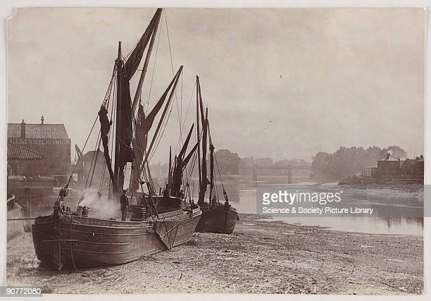 A photograph of two barges taken by Colonel Joseph Gale in about 1890 Judging by the size of the river and the advertisement for beer on the building...