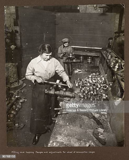 A photograph of two women at work in a British munitions factory taken by an unknown photographer during 19151918 Children and adults gather in the...