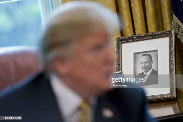 Photograph of U.S. President Donald Trump's father, Fred Trump, sits on a desk past President Trump, left, during a meeting with Chinese Vice Premier...