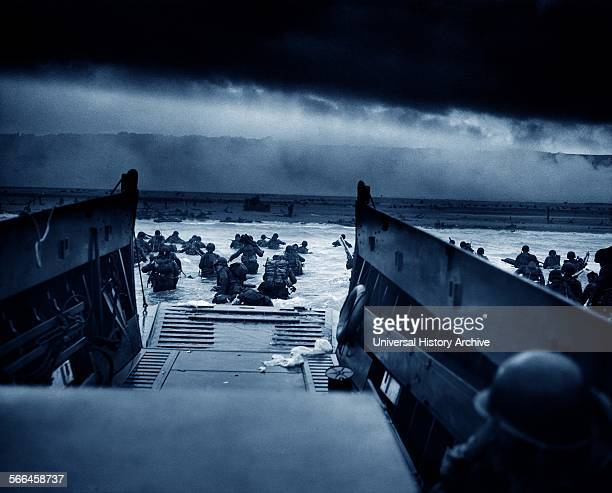 Photograph of US Troops rushing to the Normandy Beaches in France during the DDay landing Dated 1944
