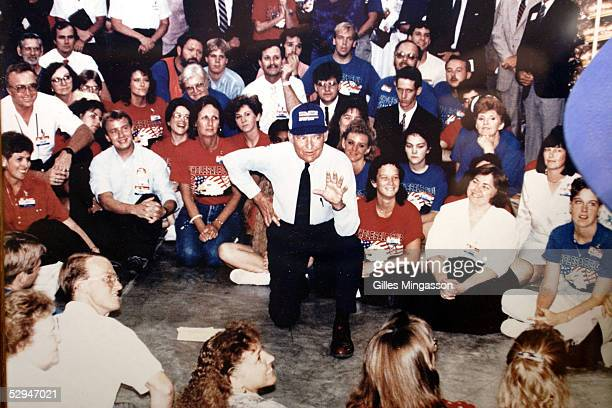 A photograph of WalMart founder Sam Walton speaking to employees is displayed at the WalMart museum March 17 2005 in Bentonville Arkansas The Museum...