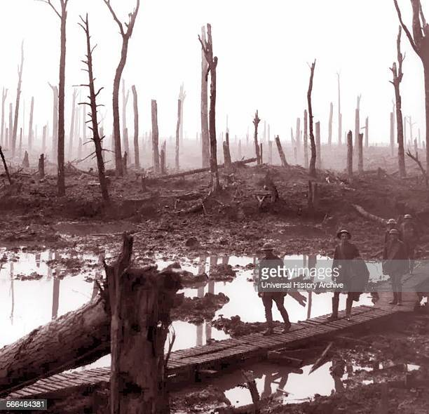 Photograph of World War One Australian soldiers passing through mud fields at Chateau Wood, near Hooge in the Ypres region, October 1917.