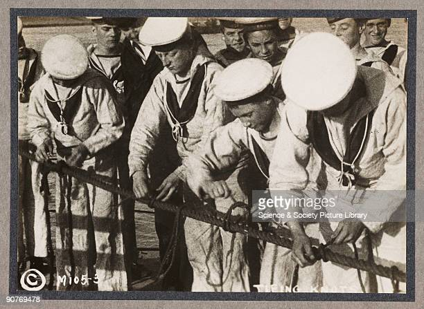A photograph of young sailors practicing to tie knots taken by an unknown photographer in about 1916 This photograph is from an album entitled...