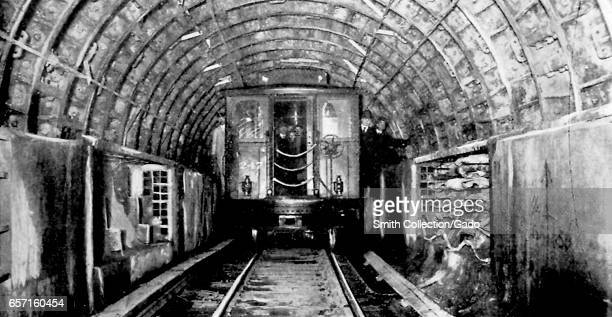 Photograph showing a subway car traveling through a tunnel during construction of the Hudson and Manhattan Tunnels New York City New York 1908