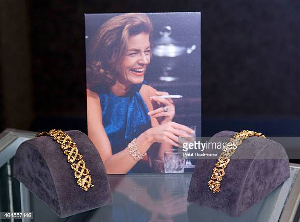 Photograph showing actress Lauren Bacall wearing bracelets on display, foreground, designed by Jean Schlumberger at The Lauren Bacall Collection at...