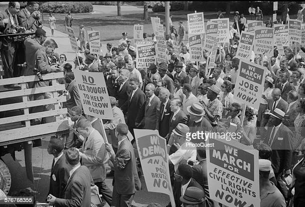 Photograph showing civil rights leaders including Martin Luther King Jr surrounded by crowds carrying signs during the March on Washington Photo by...