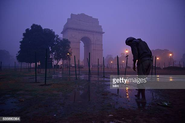 Photograph showing early morning fog in winter at India Gate on December 9 2015 in New Delhi India