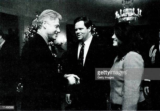 Photograph showing former White House intern Monica Lewinsky meeting President Bill Clinton at a White House Christmas part December 16, 1996...