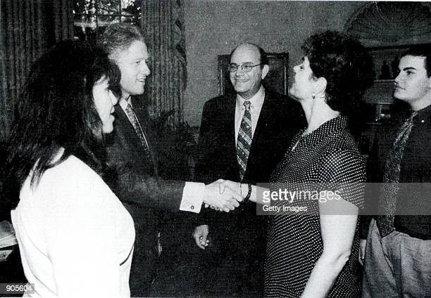A photograph showing former White House intern Monica Lewinsky meeting President Bill Clinton at a White House function submitted as evidence in...