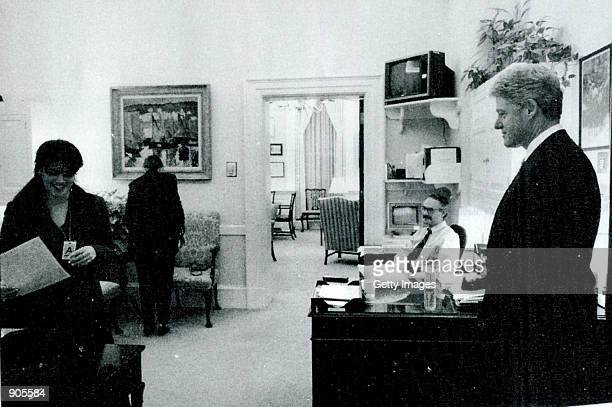 A photograph showing former White House intern Monica Lewinsky working in a White House office as President Bill Clinton looks on submitted as...