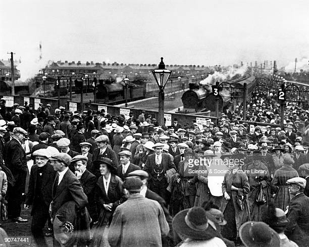 Photograph showing miners and their families arriving at Talbot Road station Blackpool on 21 June 1919 The miners are heading to the football ground...