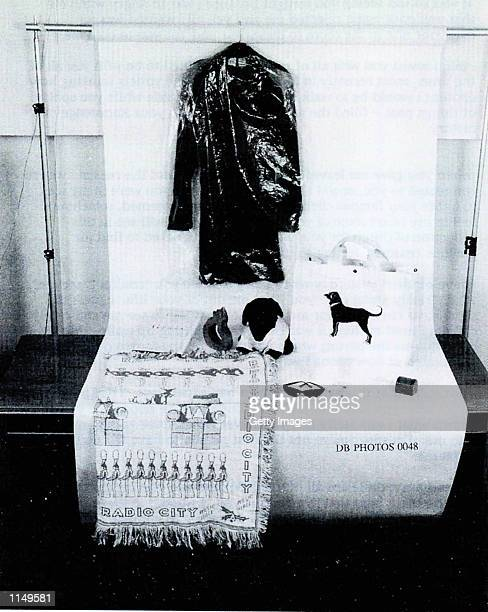 A photograph showing the blue dress worn by former White House intern Monica Lewinsky along with other items related to her relationship with...