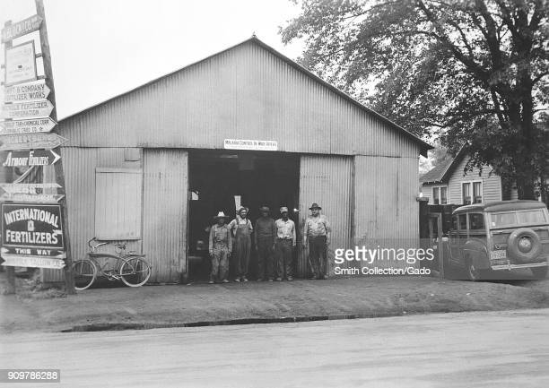 Photograph showing the front of a warehouse building which served as a field office for the World War 2 agency MCWA a predecessor of the CDC with a...