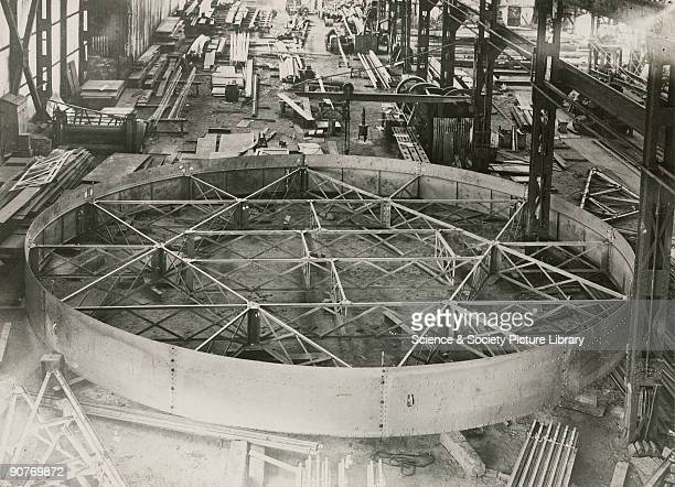 Photograph showing the interior of the works of Sir Howard Grubb Parsons and Co in NewcastleuponTyne England In view is the construction of the...