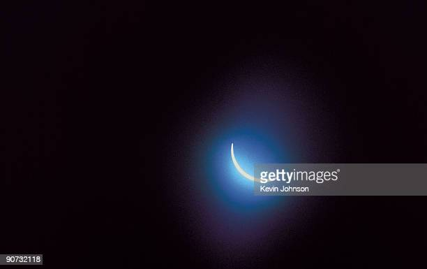 Photograph showing the sun just before the second stage of a total solar eclipse in which the moon moves in front of the sun and blocks off its...