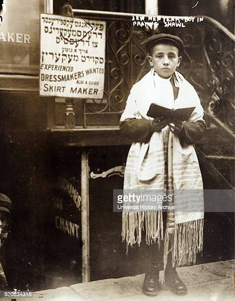 Photograph shows a Jewish boy wearing prayer shawl East Side New York City Dated 1911