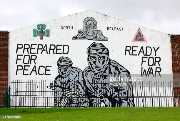 A photograph shows a Loyalist Ulster Volunteer Force mural in north Belfast on October 19 2019 British MPs voted Saturday to delay taking a decision...