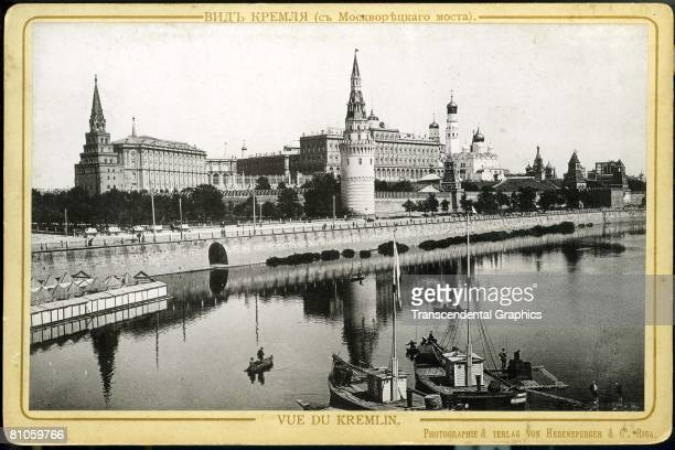 A photograph shows boats floating in the Moskva River near the Kremlin Moscow Russia early 20th century The cabinet card was published by...