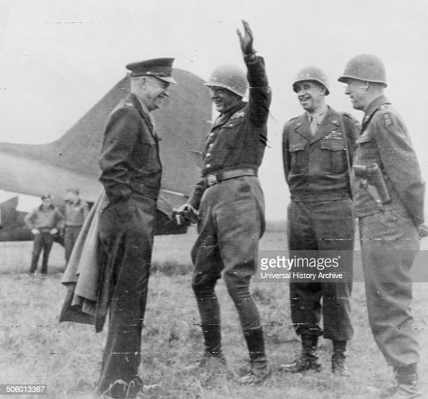 Photograph shows General Eisenhower meeting with generals Patton Bradley and Hodges on an airfield somewhere in Germany Dated 1945 Photo by