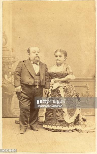 Photograph shows PT Barnum performers Charles Sherwood Stratton General Tom Thumb and Mercy Lavinia Warren Bump in a portrait taken late in their...