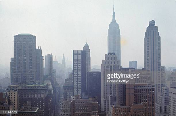 Photograph shows the sklyine of midtown Manhattan obscured by smog as one looks south New York July 30 1970 Among the visible are from left to right...