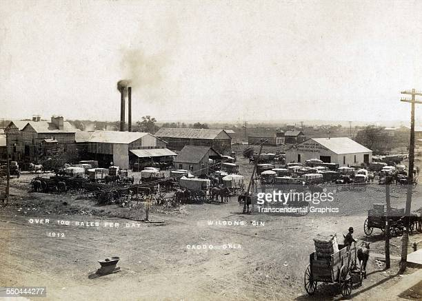 Photograph shows work going on at Wilsons Gin Mill Caddo Oklahoma circa 1900