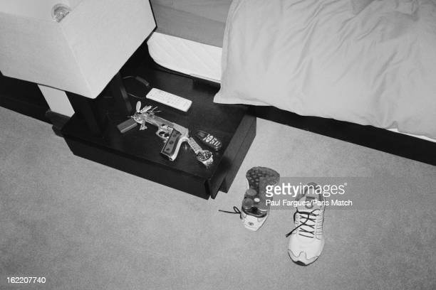 Photograph taken at the home of Oscar Pistorius showing contents of a bed side table in his bedroom including a Taurus hand gun photographed for...